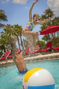 Father Tossing Daughter into Pool, PGA National Resort and Spa, Palm Beach Kuvituskuvat