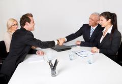 business people closing the deal - stock photo