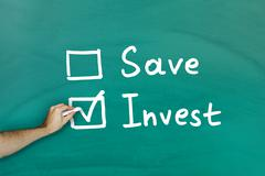 invest instead of saving concept - stock photo