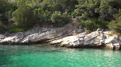 Peace oh heaven, turquoise water, rocky coastline, green pines  Stock Footage