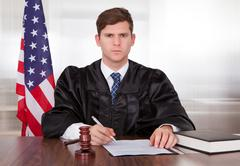 male judge in courtroom - stock photo