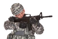 close-up of solider aiming at direction - stock photo