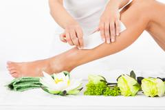 Woman getting legs waxed Stock Photos