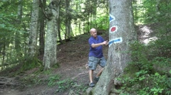 Tourist Examines Path Indicators Tourism Guidance Signs Holiday Mountain Route Stock Footage
