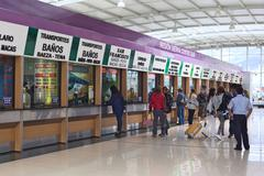 ticket offices at quitumbe bus terminal in quito, ecuador - stock photo