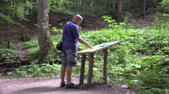 Hiker Examine Touristic Map Guidance Indicator Find Mountain Route Vacation Trip Stock Footage