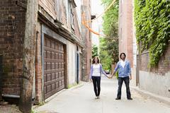 Portrait of Young Couple Standing in Alleyway, Toronto, Ontario, Canada Stock Photos
