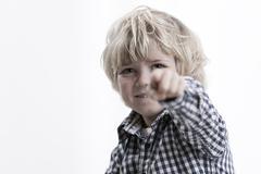 Portrait of Boy Pointing - stock photo