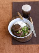 Beef Patty, Peas, Mashed Potatoes and Glass of Beer - stock photo