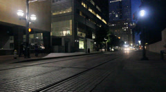 Long passing DART train in Downtown Dallas at night Stock Footage
