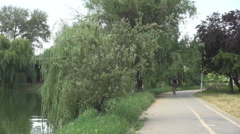 Young boy riding a bike into park sport outdoor for stressful worker, relaxation Stock Footage