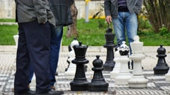 4K, Pensioners play chess on street in sarajevo Stock Footage