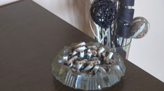 Ashtray full of butts, hard core smoker tools, bad habit for young people, home Stock Footage