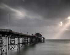 Long exposure landscape of victorian pier  witn moody sky Stock Photos