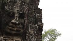 Giant Stone Faces at Bayon Temple, Angkor, Siem Reap, Cambodia Stock Footage