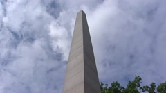 De Naald (Needle) tilt down obelisk (1901) + pan villa Stock Footage
