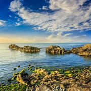 calm sea wave wash boulders - stock photo