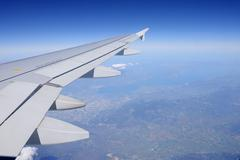Airplane Wing, Flying Over Europe - stock photo