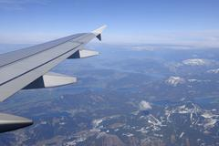 Airplane Wing, Flying Over the Lakes in Salzkammergut, Austria - stock photo