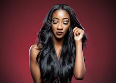 black woman with long luxurious shiny hair - stock photo