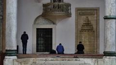 Muslim people pray at the begova mosque sarajevo Stock Footage