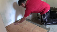 Man work at home renovation floor tiling Stock Footage