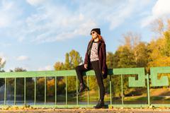 Fashion woman in autumn park - stock photo