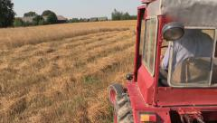 Farmer man drive red old tractor between farm agriculture fields Stock Footage