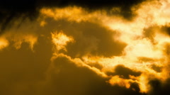 Telephoto sunset clouds timelapse golden colours and light beams Stock Footage