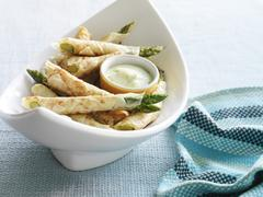 Asparagus Wrapped in Phyllo Pastry with Lemon Herb Sauce - stock photo
