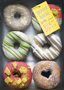 Designer Donuts with Note - stock photo