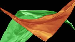 Orange and green color fabrics flying in midair, Slow Motion Stock Footage