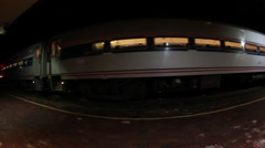 Super wide angle shot of passenger train leaving station Stock Footage