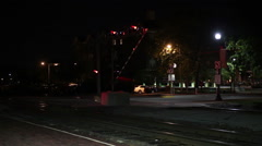 Time lapse of freight train coming through town at night Stock Footage