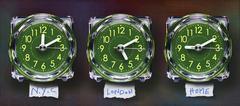 Panoramic of Three Plastic Clocks Showing Time Zones, Studio Shot - stock photo