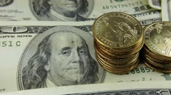 Commodity Trading US Currency One Hundred Dollar Bill with gold coins Stock Footage