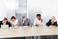 Frustrated corporate personnel officers at panel Stock Photos