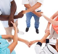 Multi-racial hands holding each other Stock Photos