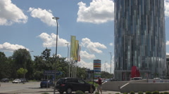 Tallest building in town, round construction shopping mall, car traffic outdoor Stock Footage