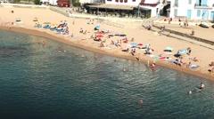 Aerial shot Sandy Beach. Mediterranean sea. People swimming and sunbathing Stock Footage