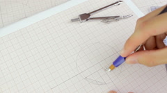 Close-up of person correcting the plan from above, erasing, engineering Stock Footage
