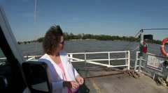 Woman standing next to car on ferry crossing Mississippi River Stock Footage