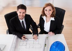 portrait of two sincere architects - stock photo