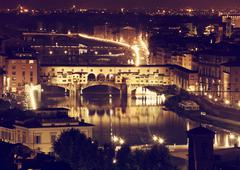 Florence, arno river and ponte vecchio by night. Stock Photos