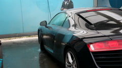 An Audi R8 in an Iwash self serve vehicle car wash system Stock Footage