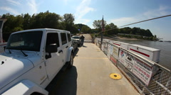 White Jeep on small ferry crossing Mississippi River Stock Footage
