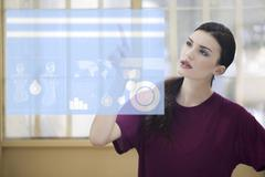 Young Businesswoman using Digital Display, Studio Shot - stock illustration