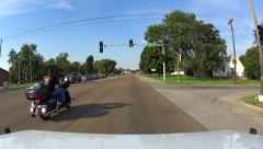 From stop light motorcycle pulls ahead Stock Footage