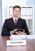 Male accountant working in office Stock Photos