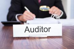 auditor looking at document - stock photo